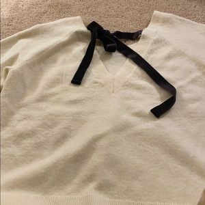 JCrew cream sweater w/black velvet ribbon on back